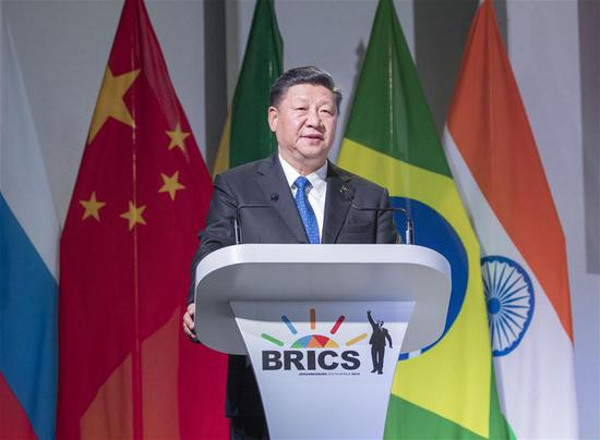 Xi says China firmly supports free trade